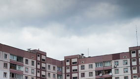 Clouds Moving over the Multistorey Buildings Time Lapse. Yard in the city with high-rise buildings over which the clouds moving in the sky. ULTRA HD 3840 x 2160 stock footage