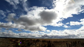 Clouds moving over patagonia plains stock video