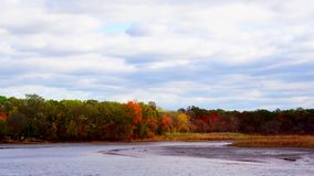 Clouds Moving Over River and Fall Trees. Fall River clouds stock video footage