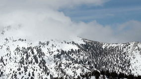 Clouds Moving Over Snow Covered Mountain Nevada stock video footage
