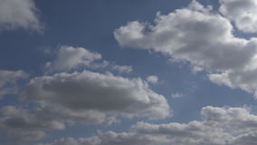 Clouds moving over sunny sky timelapse stock footage