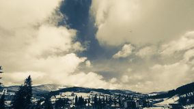 Clouds moving over the top of the mountain stock footage