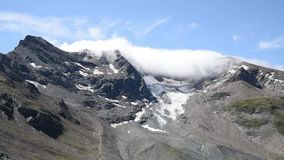 Clouds moving in the peaks of Alps mountain range stock video footage