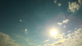 Clouds moving in the sky, the sun is shining stock video footage