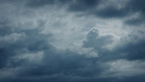 Clouds Moving Slowly Over Dramatic Sky. Large storm clouds forming and moving across the sky stock video footage