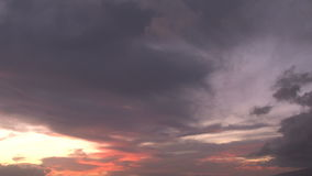 Clouds moving at sunset stock footage