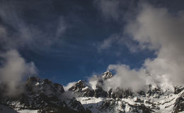 Clouds Near Snow Covered Mountains Royalty Free Stock Photos