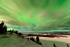 Clouds and Northern Lights over Lake Laberge Yukon Royalty Free Stock Image