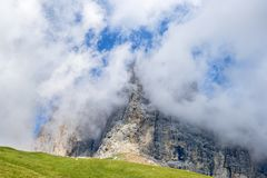 Clouds that obscure a mountain peak royalty free stock photography