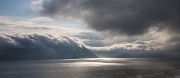 Clouds and ocean. Scenic picture of the ocean with moody clouds. Faeroe Islands Stock Photos