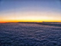 Clouds and the ocean in the sunset from above, from an airplane.  stock photo