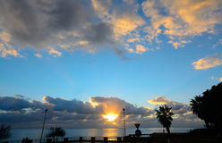 Clouds over Alghero coast at sunset. Italy Royalty Free Stock Images