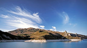 Clouds over the alpine lake. Sky with beautiful clouds over the Alps lake Lac de Castillon Stock Images