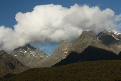 Clouds over alpine peaks in Fiordland National Park Royalty Free Stock Image