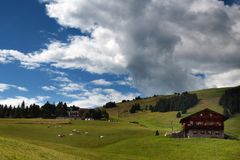 Clouds over an alpine village Royalty Free Stock Photography