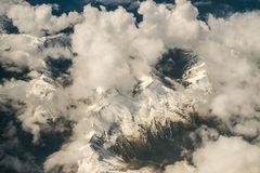 Clouds over the Alps. Flying over the Souther Alps near Queenstown, New Zealand Royalty Free Stock Photos