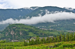 Clouds over the Alps. Low rain clouds over the Alps in Italy Royalty Free Stock Image