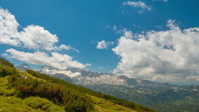 Clouds over the Alps. Time Lapse UHD stock video footage
