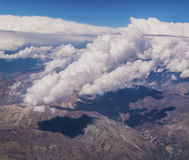 Clouds over the Andes. View of Andes Mountains form a plane. Border between Chile and Argentina Royalty Free Stock Photos