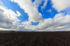 Clouds over arable land close-up Royalty Free Stock Image