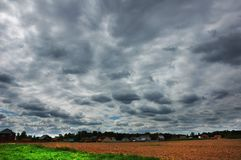 Clouds over arable land. Near Moscow region, Russia Royalty Free Stock Photo