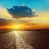 Clouds over asphalt road on sunset Stock Image