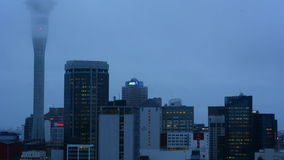 Clouds over Auckland Sky Tower and financial city center - New Zealand stock video footage