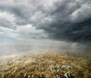 Clouds over the autumn field Royalty Free Stock Photos