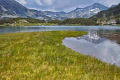 Clouds over Banderishki chukar peak and Reflection in Muratovo lake, Pirin Mountain Stock Images