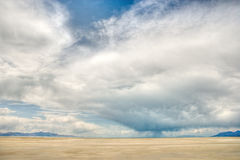 Clouds over bare desert Stock Photography