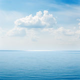 Clouds over blue sea. Picture of clouds over blue sea Stock Photo