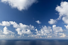 Clouds over Blue Skies and Sea Royalty Free Stock Images