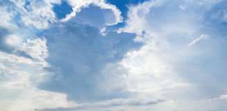Clouds over blue sky, background texture. Clouds over blue sky in daytime, panoramic background photo texture Stock Images
