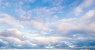 Clouds over blue sky in summer day, background. Photo texture Stock Photo