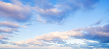 Clouds over blue sky in summer evening Royalty Free Stock Photography