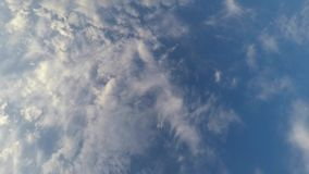 Clouds over the blue sky, time-lapse stock video footage