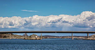 Clouds over bridge. Stock Images