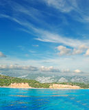 Clouds over Cala Gonone. Cala Gonone shoreline on a cloudy day, Sardinia Royalty Free Stock Photo