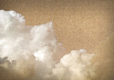 Clouds over cardboard Stock Image