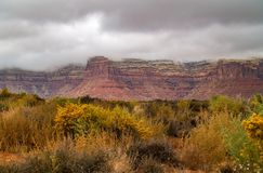Clouds over Cedar Mesa near Mexican Hat. Low clouds and fog hang over Cedar Mesa and threaten to bring rain to the arid desert area near Mexican Hat, Utah royalty free stock photos