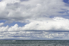 Clouds over a choppy lake Royalty Free Stock Photos
