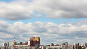 Clouds over the city timelapse stock footage