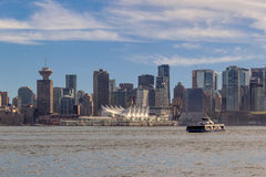 Clouds over city of Vancouver in Canada - panoramic view. Vancouver, Canada - June 6, 2016. Clouds over Vancouver in Canada - panoramic view Royalty Free Stock Images