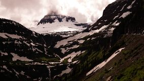 Clouds over clements mountain in glacier national park stock footage