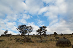 Clouds Over Dry Farmland Royalty Free Stock Photos