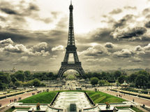 Clouds over Eiffel Tower in Paris Stock Photos