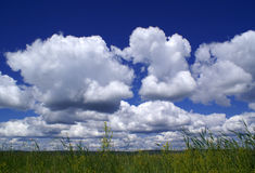 Clouds over a field Stock Images