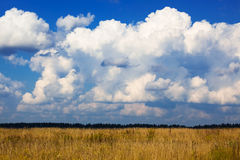 Clouds over a field Stock Photography
