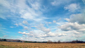 Clouds over the field. Early Spring Stock Images