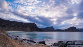Clouds over a fjord on Gimsoy in a timelapse Stock Images